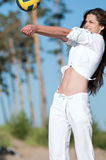 Woman playing volleyball on beach Royalty Free Stock Photo