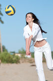 Woman playing volleyball on beach Royalty Free Stock Photography