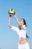 Woman playing volleyball on beach Stock Image