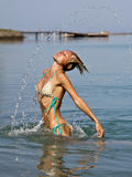 Woman playing in water Stock Photos