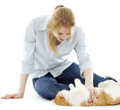 Woman playing with white ore cat Royalty Free Stock Photo
