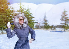 Woman playing in winter park Stock Photography