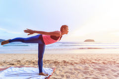 Woman playing Yoga and exercise on the tropical beach in Thailan Stock Image