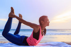 Woman playing Yoga and exercise on the tropical beach in Thailan Stock Images