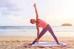 Woman playing Yoga and exercise on the tropical beach in Thailan Royalty Free Stock Images