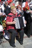 A woman plays accordeon. Stock Photo