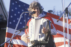 A woman plays the accordion. In front of the American flag, Hannibal, MO Royalty Free Stock Photography