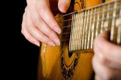 The woman plays an acoustic guitar Royalty Free Stock Photos