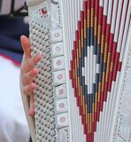 Woman plays the ancient accordion keyboard Stock Image