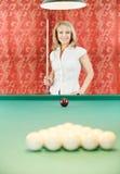 Woman plays billiards Stock Photos