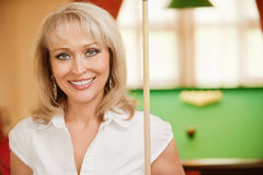 Woman plays billiards Royalty Free Stock Images