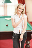 Woman plays billiards Stock Photos