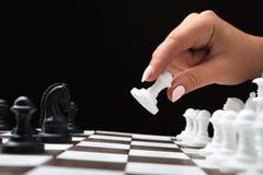 Woman plays chess Stock Photos