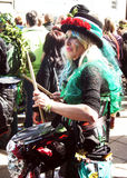 Woman plays drum in carnival Stock Photo