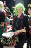 Woman plays drum in carnival Stock Images