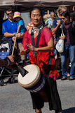 Woman plays drum Royalty Free Stock Images