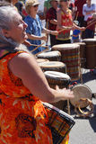 Woman plays drum Royalty Free Stock Photo