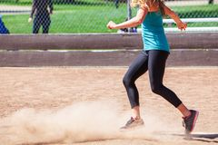 A Woman Plays a Game of Kickball. On a sunny day at a park. Kickball is played on a standard baseball field royalty free stock images