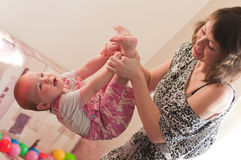 Woman plays with girl Stock Photography