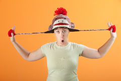 Woman Plays with Hat Royalty Free Stock Photo