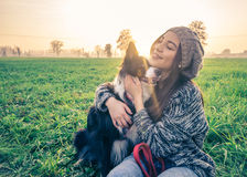 Woman plays with her dog Royalty Free Stock Image