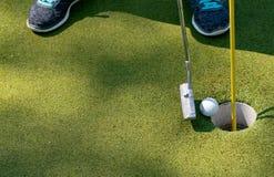 Woman plays miniature golf royalty free stock photo