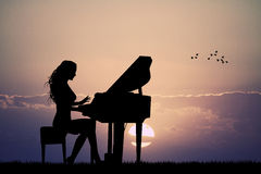 Woman plays the piano at sunset. Illustration of woman plays the piano at sunset Stock Photos