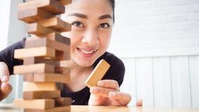 Woman plays puzzle blocks. Royalty Free Stock Photos