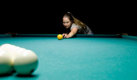 Woman plays russian billiards Royalty Free Stock Images