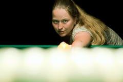 Woman plays russian billiards Stock Photos
