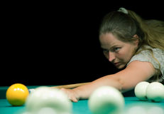 Woman plays russian billiards Stock Photos