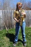 Woman plays saxophone outdoors Stock Photos