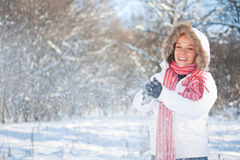 Woman plays with a snow Stock Photo