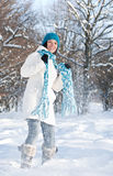 Woman plays with a snow Royalty Free Stock Photography