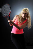 A woman plays tennis Stock Image