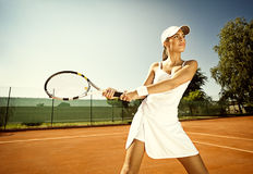 Woman plays tennis stock images
