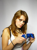 Woman plays video game. Young nice girl plays video game royalty free stock image