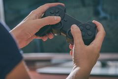 Woman plays video game using the gamepad royalty free stock image