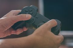 Woman plays video game using the gamepad royalty free stock photos
