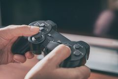 Woman plays video game using the gamepad stock photos