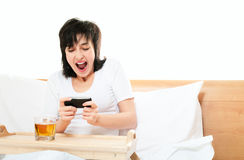 Woman plays video games on mobile Stock Photos