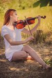 Woman plays violin royalty free stock photo