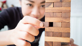 Woman plays wooden blocks Stock Photography