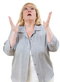 Woman pleading. Mature woman looks up with hands raised stock image