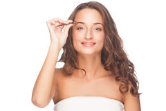 Woman plucking eyebrows Royalty Free Stock Images