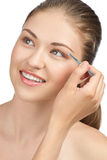 Woman plucking her eyebrows Stock Photo