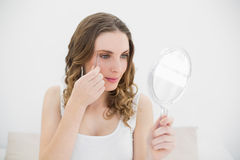 Woman plucking her eyebrows royalty free stock photography