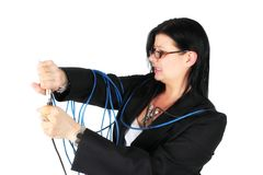 Woman plugging in cables Royalty Free Stock Photo