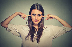 Woman plugging ears doesn't want to listen Royalty Free Stock Photos