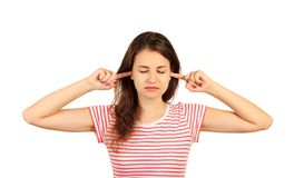 Woman plugging ears with fingers and closing eyes tight, irritated with loud annoying noise. emotional girl isolated on white back. Ground Stock Photos
